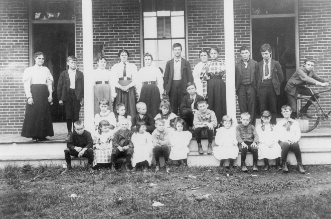 My grandfather, George Dinsmore Sr., on the far left, next to the teacher at the brick school house in Windham NH.