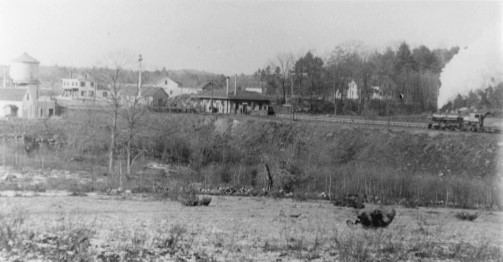 A train pulls into Windham Junction with Armstrong Store at top left.