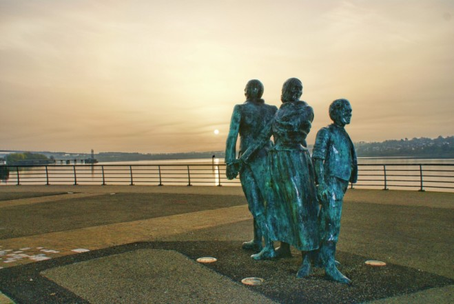 The Blight of Emigration Statues, are located on Derry Harbor, Northern Ireland. The man moves resolutely ahead, while the woman and child look back toward what's being left behind.